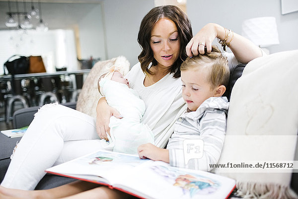 Woman spending time with children (0-1 months  4-5)
