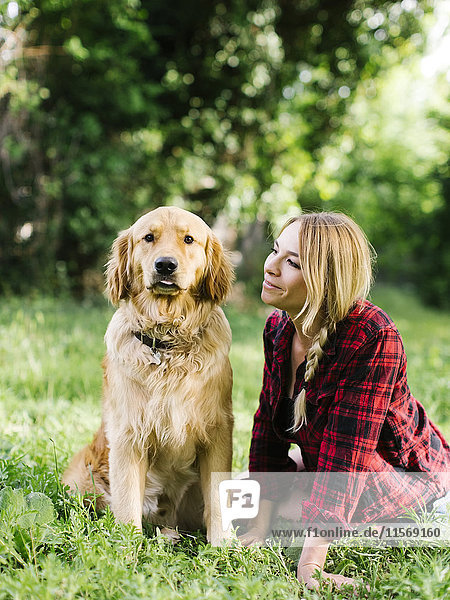 Portrait of woman with dog in nature