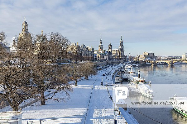Snowy historic centre with Elbe and pier for steamboats  dome of the Church of Our Lady  Art Academy  Sekundogenitur  Hausmannsturm  House of the Estates  Hofkirche  Semper Opera and Augustus Bridge  Dresden  Saxony  Germany  Europe