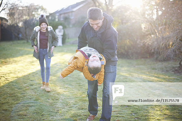 Happy family playing in garden