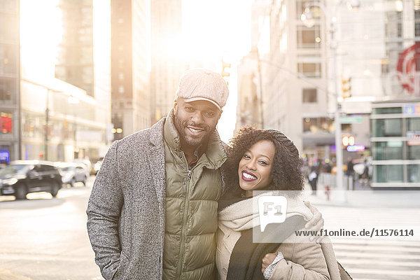 Portrait of couple on street  New York  USA