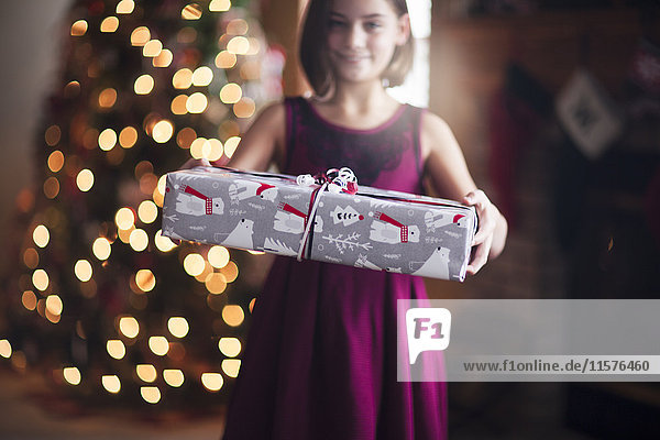 Young girl holding christmas gift