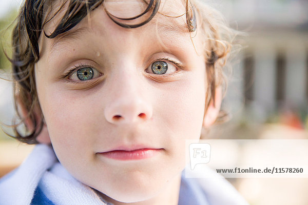 Close up portrait of boy with wet hair
