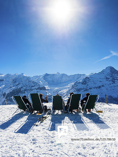 Switzerland  Canton of Bern  Grindelwald  view from First to Wetterhorn and Eiger  skiers sitting on deckchairs in the sun
