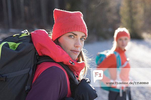 Portrait of two women hiking along lakeside in Bavarian Alps
