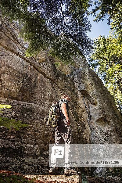 Mid adult man trekking through Murrin Provincial Park  Squamish  British Columbia  Canada