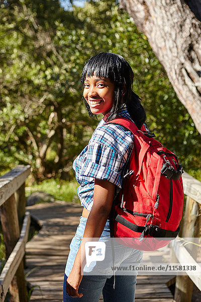 Portrait of young woman  hiking  standing on bridge  Cape Town  South Africa