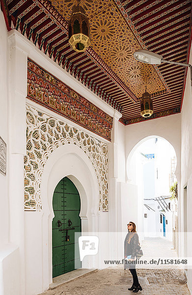 Woman exploring  Kasbah  Tangier  Morocco  North Africa