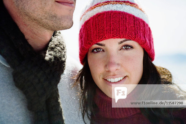 Woman in winter hat smiling next to man