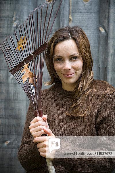 Woman holding garden rake