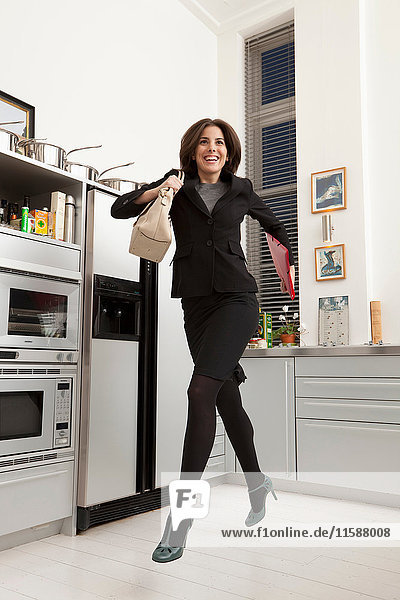 businesswoman running out the kitchen