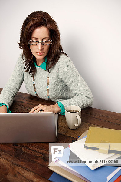 Mature woman working on laptop