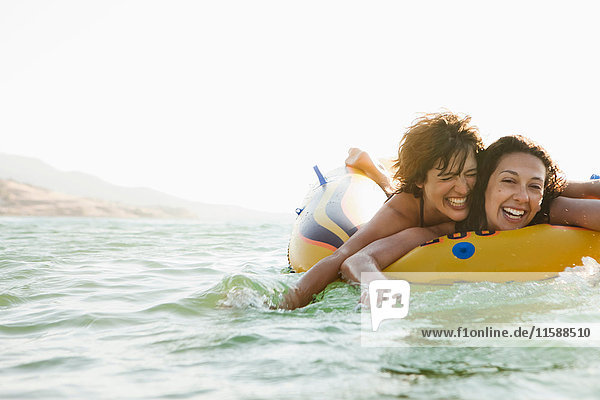 Women in inflatable boat in water