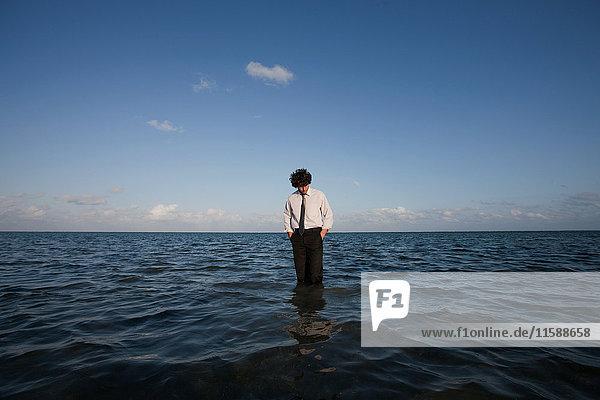 Businessman standing in sea