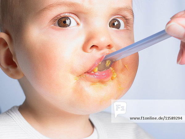 Portrait of a baby boy  eating
