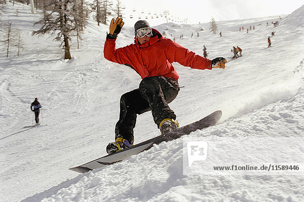 Male in action on a snowboard