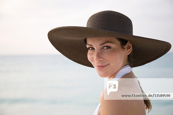 Woman on Beach Smiling at Camera