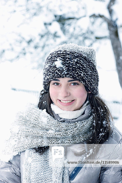 Young woman in winter outfit smiling