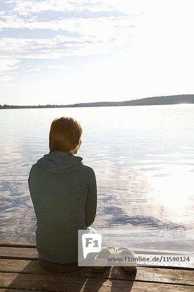 Woman sat on Dock