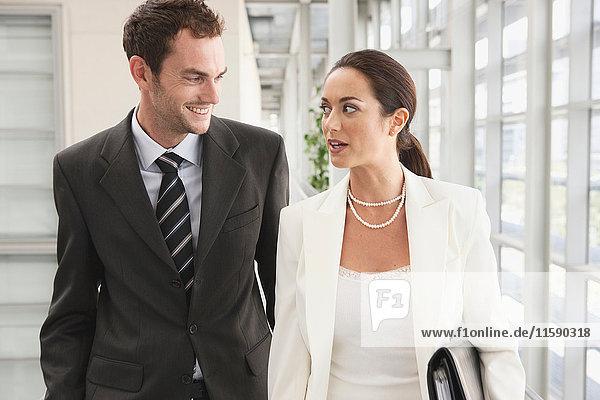 Business couple in corridor