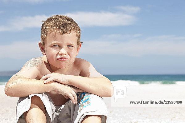 Boy sitting on beach
