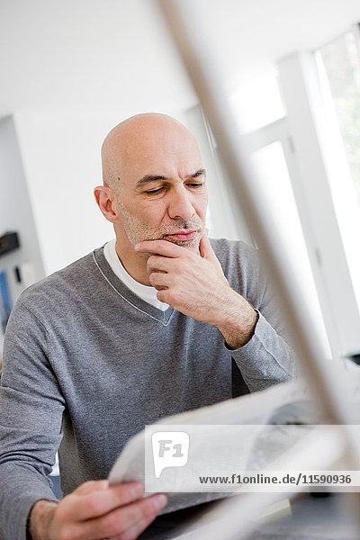 Businessman studying papers