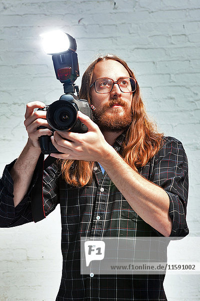 Photographer with flash on camera