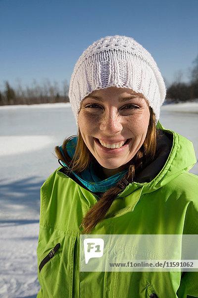Woman Smiling by Frozen Lake