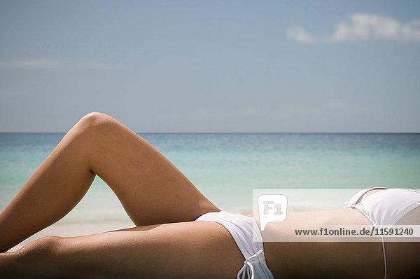 Woman Sunbathing on Tropical Beach