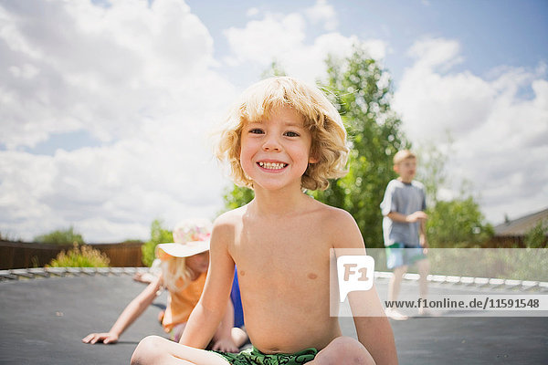 Young boy smiling on trampoline