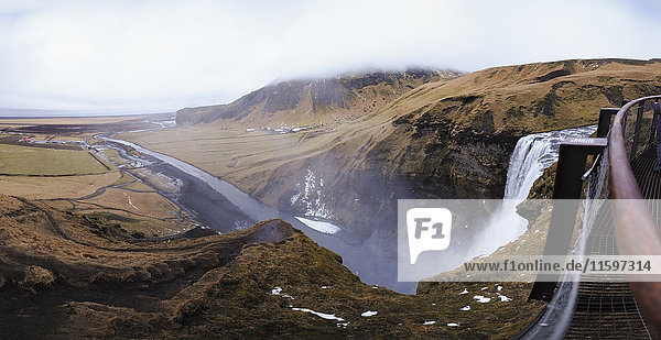 Iceland  panoramic view of Skogafoss waterfall from the top
