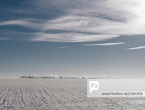 Clouds over distant winter landscape