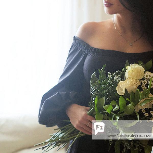 Caucasian woman holding roses