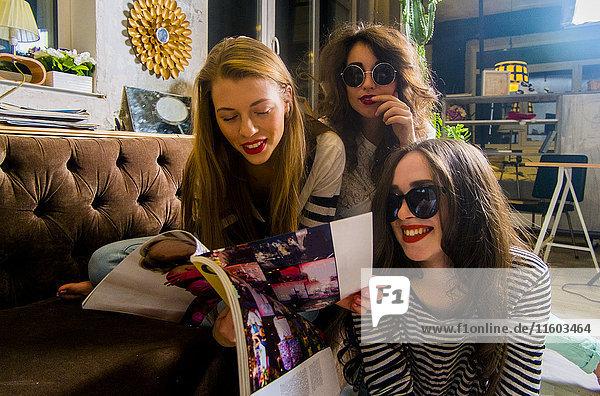 Caucasian women reading magazine