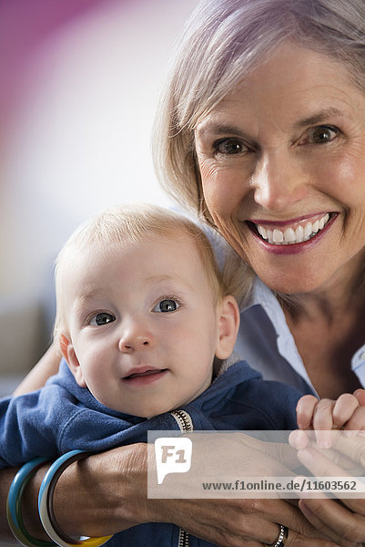 Portrait of smiling Caucasian grandmother and baby grandson