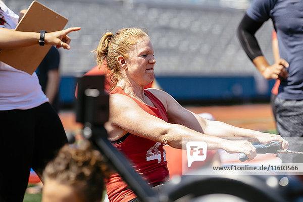 Woman using rowing machine outdoors