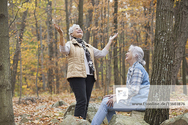 Caucasian women smiling outdoors in autumn