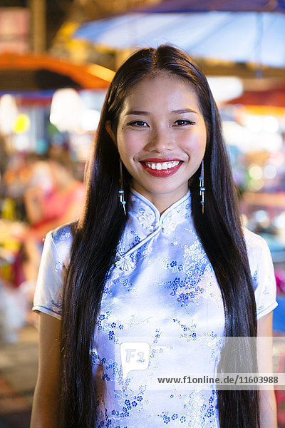 Portrait of smiling Asian woman wearing traditional clothing