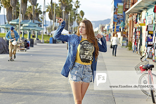 Caucasian woman walking on Venice Beach sidewalk  Venice  California  United States