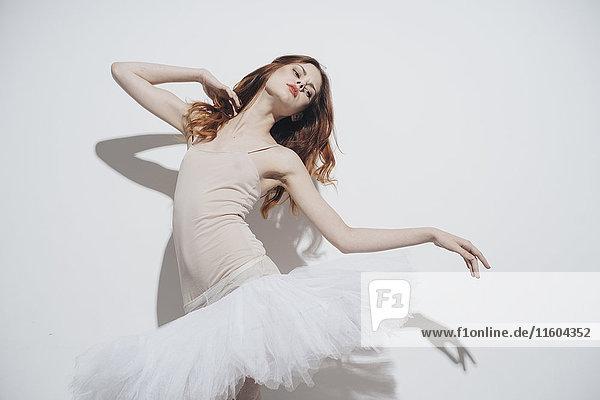 Caucasian woman dancing wearing tutu
