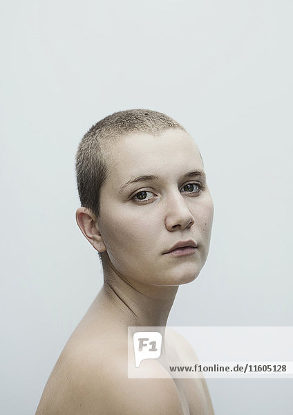 Portrait of serious Caucasian woman with shaved-head