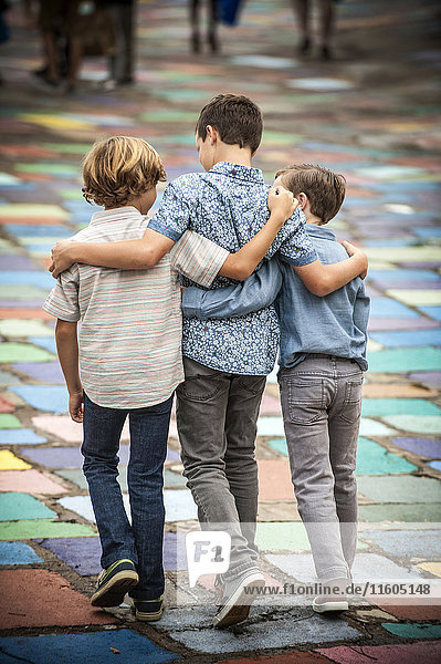 Brothers hugging and walking