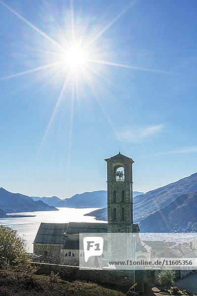 Sun in blue sky over Gravedona  Lake Como  Italy