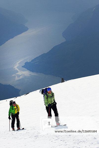 People skiing in winter landscape