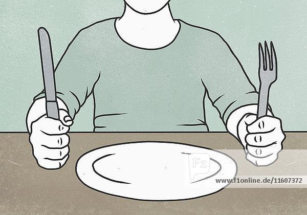 Mittelteil des Mannes mit Gabel und Messer am Tisch
