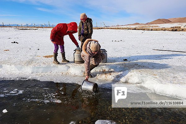 Mongolia  Bayan-Olgii province  landscape in winter  Kazakh family  water drudgery.