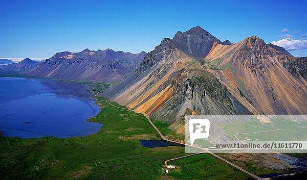 Farm in Hornafjordur Fjord with Mountains  Iceland Mt. Austurhorn and Mt. Estrahorn  Eastern Iceland.