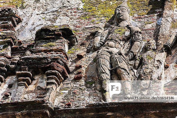 Sculpture made of brick and stucco on the outer walls of Lankatilaka Image House  Alahana Pirivena Monastery Complex built by the King Parakramabahu the Great 1153-1186 A. D  Ancient City of Polonnaruwa  North Central Province  Sri Lanka  Asia.
