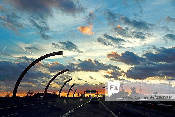 Dark storm clouds at sunset Valencia motorway in Spain.