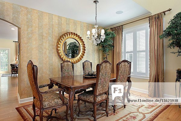 Dining room in luxury home with striped walls. Northern Suburbs of Chicago  IL. USA.